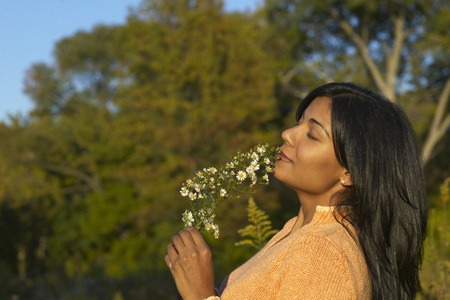 indian subcontinent ethnicity: Woman Smelling Flowers