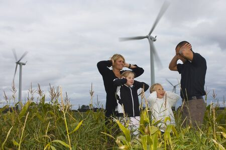 Family Covering Ears near Wind Turbines, Denmark LANG_EVOIMAGES