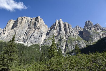 Mountains with rocky towers, Lastes Valley, into the massif of Sella, Dolomites, Trentino Alto Adige, Italy LANG_EVOIMAGES