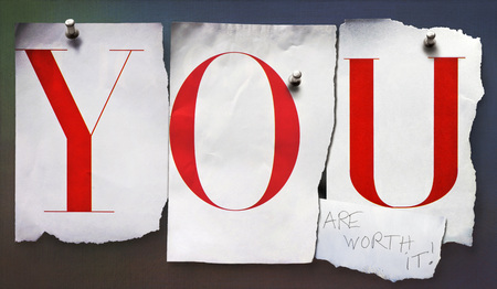 self worth: Cut out letters, YOU, pinned to wall
