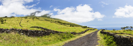 empedrado: Rural Road and Lava Stone Wall in front of Pastureland and Mount Pico, Pico Island, Azores Portugal