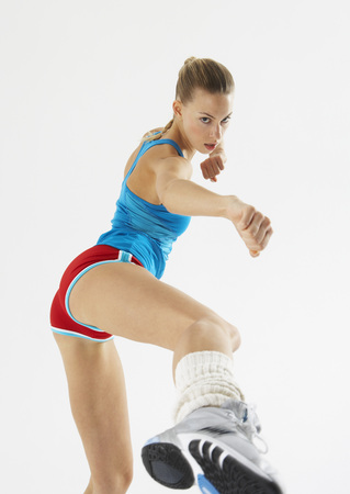 punched out: Woman Exercising LANG_EVOIMAGES