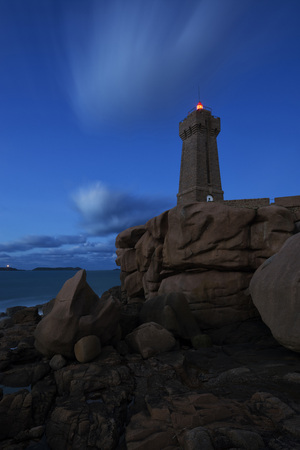 ploumanach: The Ploumanach Lighthouse at night at Grand Site Naturel de Ploumanach on Pink Granite Coast, Cotes-dArmor, Brittany, France LANG_EVOIMAGES
