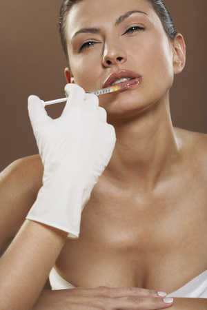 Woman Getting Botox Injection LANG_EVOIMAGES