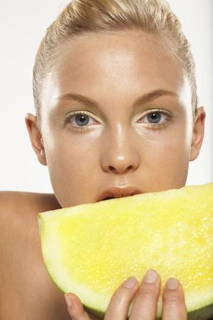 Woman Holding Melon