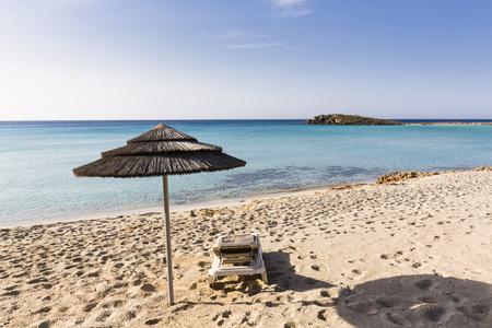 beachfront: Beach umbrella and lounge chair on Nissi Beach at the Nissi Beach Resort in Agia Napa, Cyprus