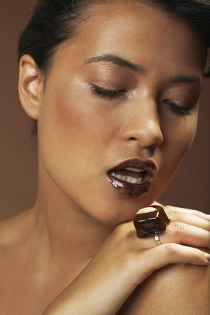 Portrait of Woman With Chocolate Ring LANG_EVOIMAGES