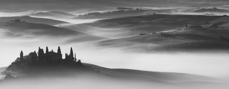 podere: Silhouette of Podere Belvedere with mist at sunrise at San Quirico DOrcia in Val dOrcia in Tuscany, Italy, in black and white LANG_EVOIMAGES