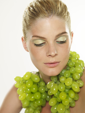 Woman Wearing Grape Necklace LANG_EVOIMAGES