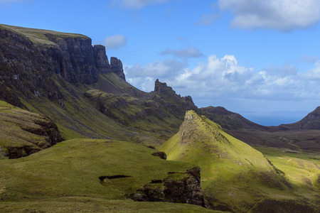 Grassy cliffs and mountain landscape on the Trotternish Peninsula on the Isle of Skye, Scotland, United Kingdom LANG_EVOIMAGES