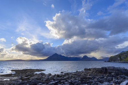 Scottish coast with dramatic clouds over Loch Scavaig on the Isle of Skye in Scotland, United Kingdom
