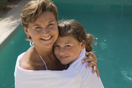 Mother and Daughter Standing by Swimming Pool, Wrapped in Towel LANG_EVOIMAGES