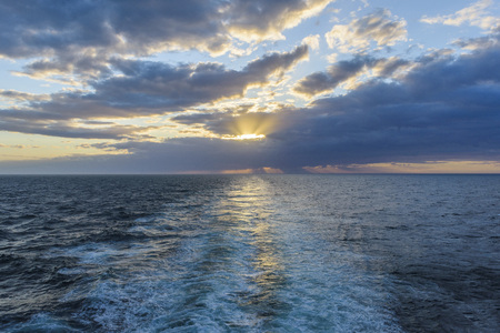 Ships wake at sunset over the North Sea, United Kingdom LANG_EVOIMAGES