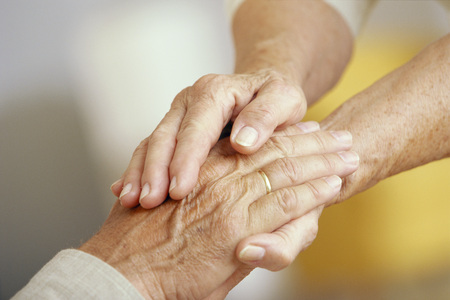 Close Up of Senior Couple With Clasped Hands