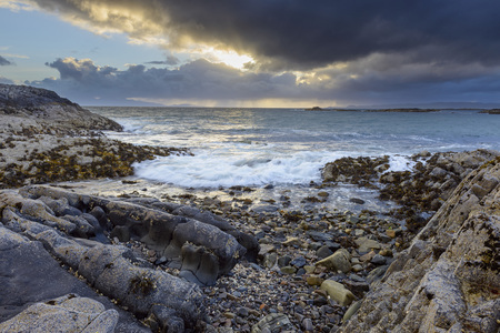 Surf along the Scottish coast at sunrise in spring at Mallaig in Scotland, United Kingdom LANG_EVOIMAGES