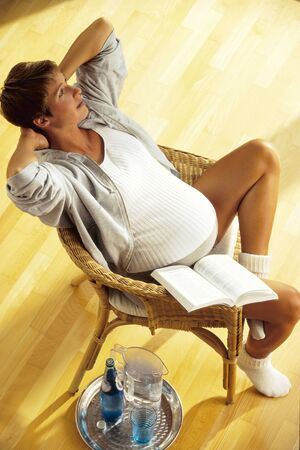 Pregnant Woman in Chair LANG_EVOIMAGES