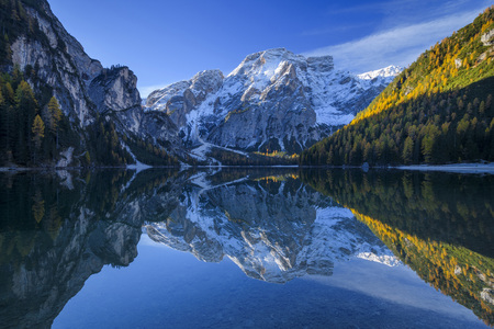 Croda del Becco (Seekofel) reflected in the calm waters of Braies Lake in autumn in the Prags Dolomites, South Tyrol, Italy LANG_EVOIMAGES