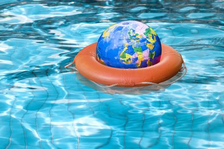 Globe in Life Preserver in Pool