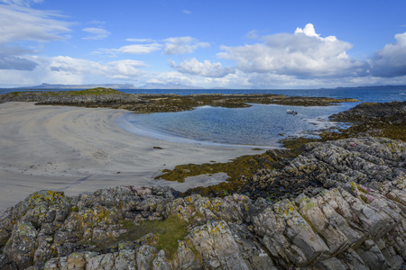 Scottish coast with beach in spring at the port of Mallaig in Scotland, United Kingdom
