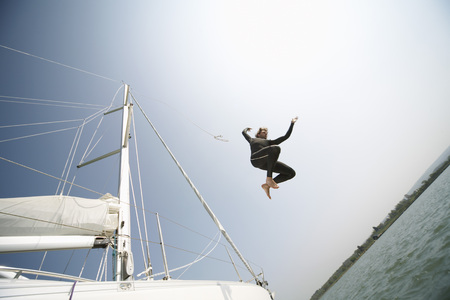 Man Jumping off Boat LANG_EVOIMAGES