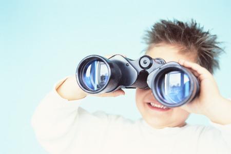 Boy Using Binoculars LANG_EVOIMAGES
