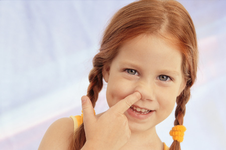 Girl Sticking Finger in her Nose