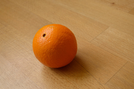 Orange on the wooden table