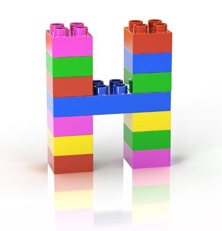 yellow block: children s toy brick font letter H