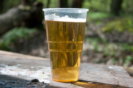 The glass of beer on the table in the nature Stock Photo