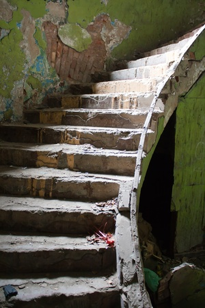 old broken staircase in the abandoned house Stock Photo