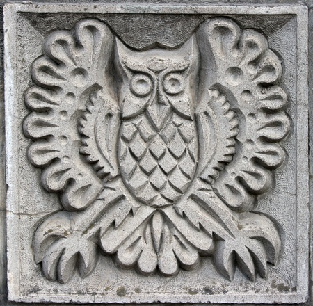 sandstone: old bas-relief of fairytale fantasy owl on the wall