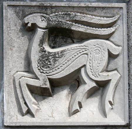 old bas-relief of fairytale fantasy deer on the wall