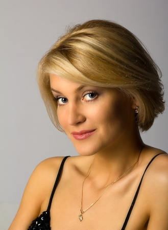 portrait of young beautiful woman posing in studio