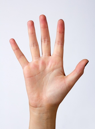 womans hand with opened palm closeup on light background Stock Photo