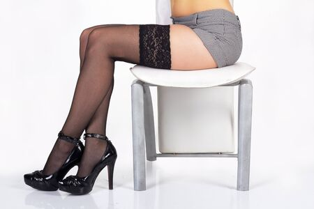 long sexy legs: long sexy legs in black stockings and shoes in studio Stock Photo