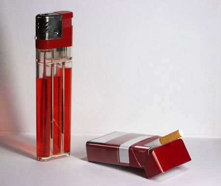 big red lighter and pack of cigarettes on the table Stock Photo - 17092355