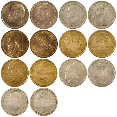 greek coins: old vintage coins of greece isolated on white background Stock Photo