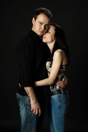 handsome young couple posing standing in studio