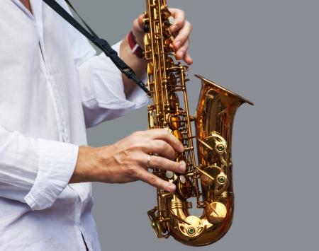 hands of a musician playing the saxophone Standard-Bild