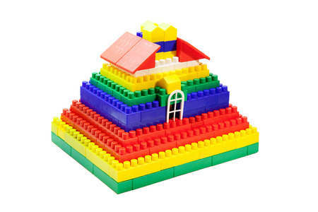 toy house out of colored blocks closeup on white background Stock Photo