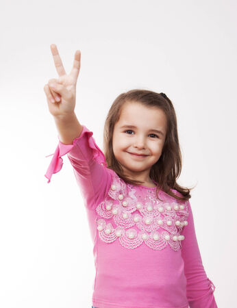 girl showing victory sign with her hand photo