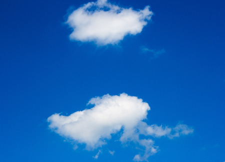 two white clouds on blue the sky