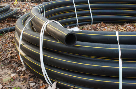 sewer pipe: black plastic sewer pipe outside closeup