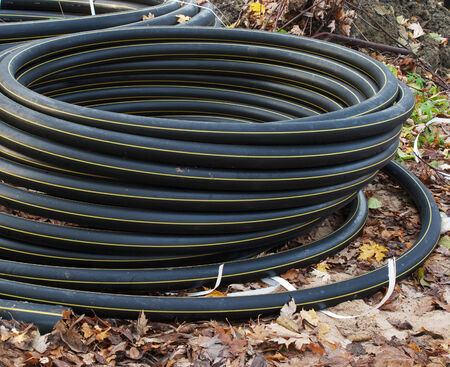 sewer: scroll of plastic sewer pipe outside closeup Stock Photo
