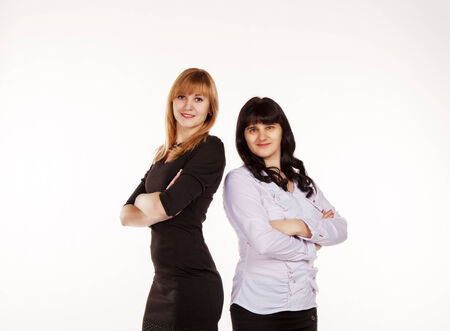 two young beautiful business women standing smiling photo