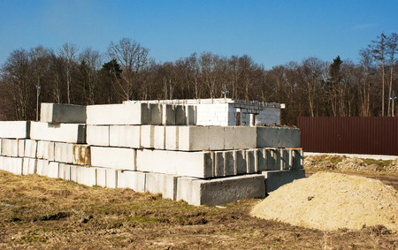 housebuilding: concrete slabs to build a house on the construction site outside Stock Photo