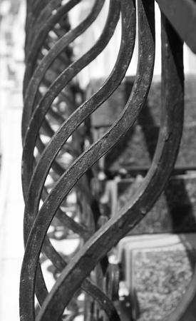grating: fragment of metal grating. geometric pattern. back and white. closeup
