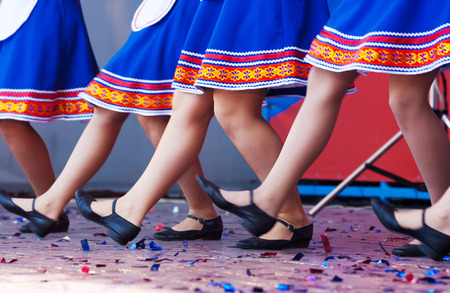 russian girls: russian girls in traditional costumes dancing on stage. legs closeup