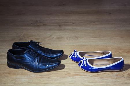 womens shoes making advances to mens shoes closeup