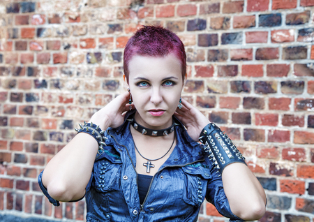 subculture: portrait of girl punk near a brick wall outdoor closeup Stock Photo